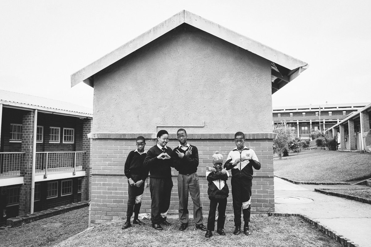 4 boys and 1 girl in the same family, including a set of twins, who are all completely deaf attending the school.