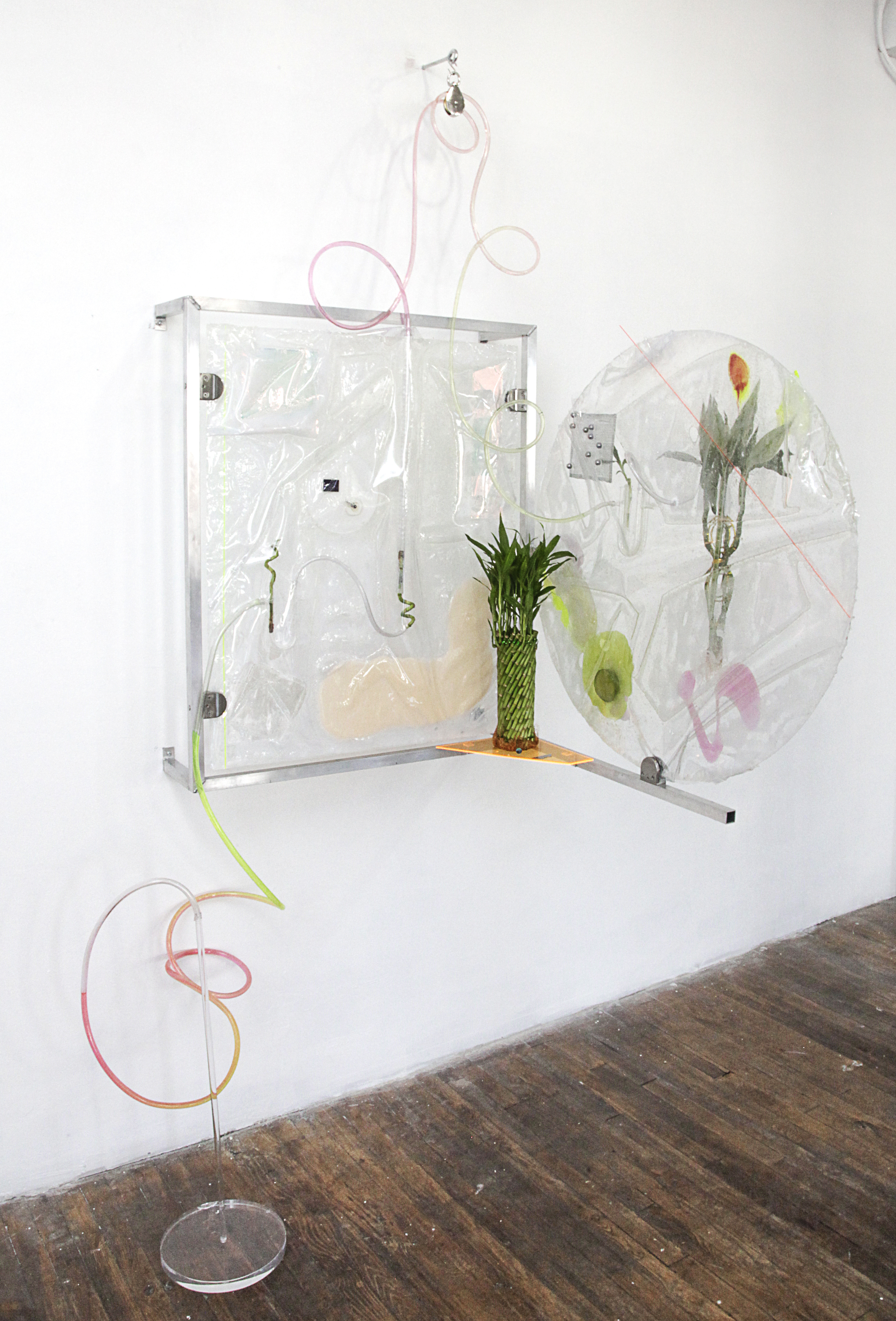 Heidi Norton ,  The Plight (feeding Systems) ,2015, Acrylic, dielectric glass, resin, vinyl, bamboo, tubing, electrodes with thermal switch, burner screen, pulley, crystal soil water beads, U- shaped draying tubes, aluminum frame, LCD screens, ball bearings