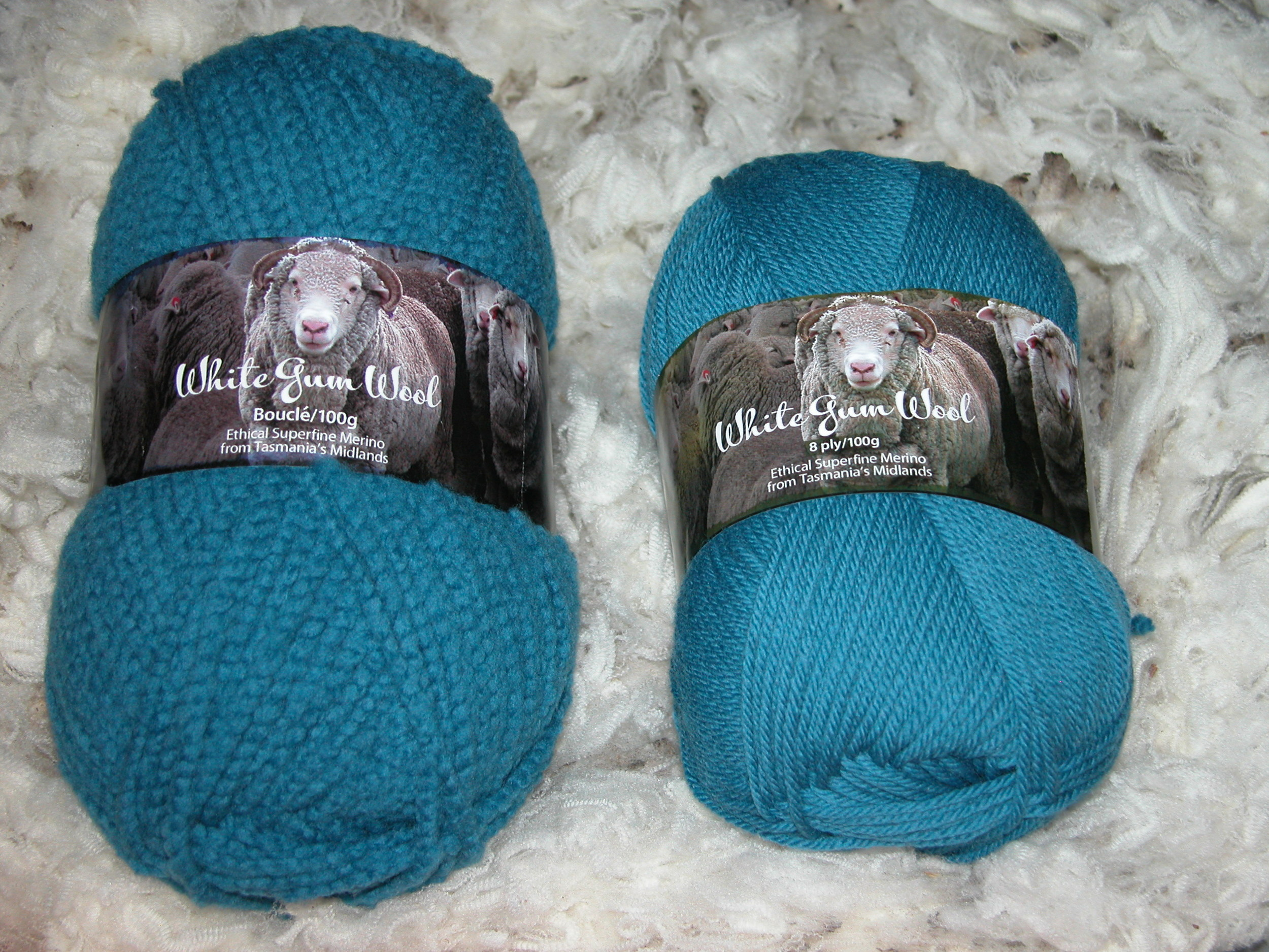 Big brother boucle next to standard 8-ply (DK) in fairy wren