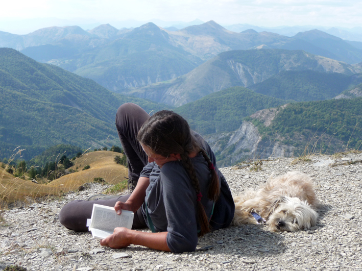 Shepherdess Marie Labreveux and canine colleague at midday rest