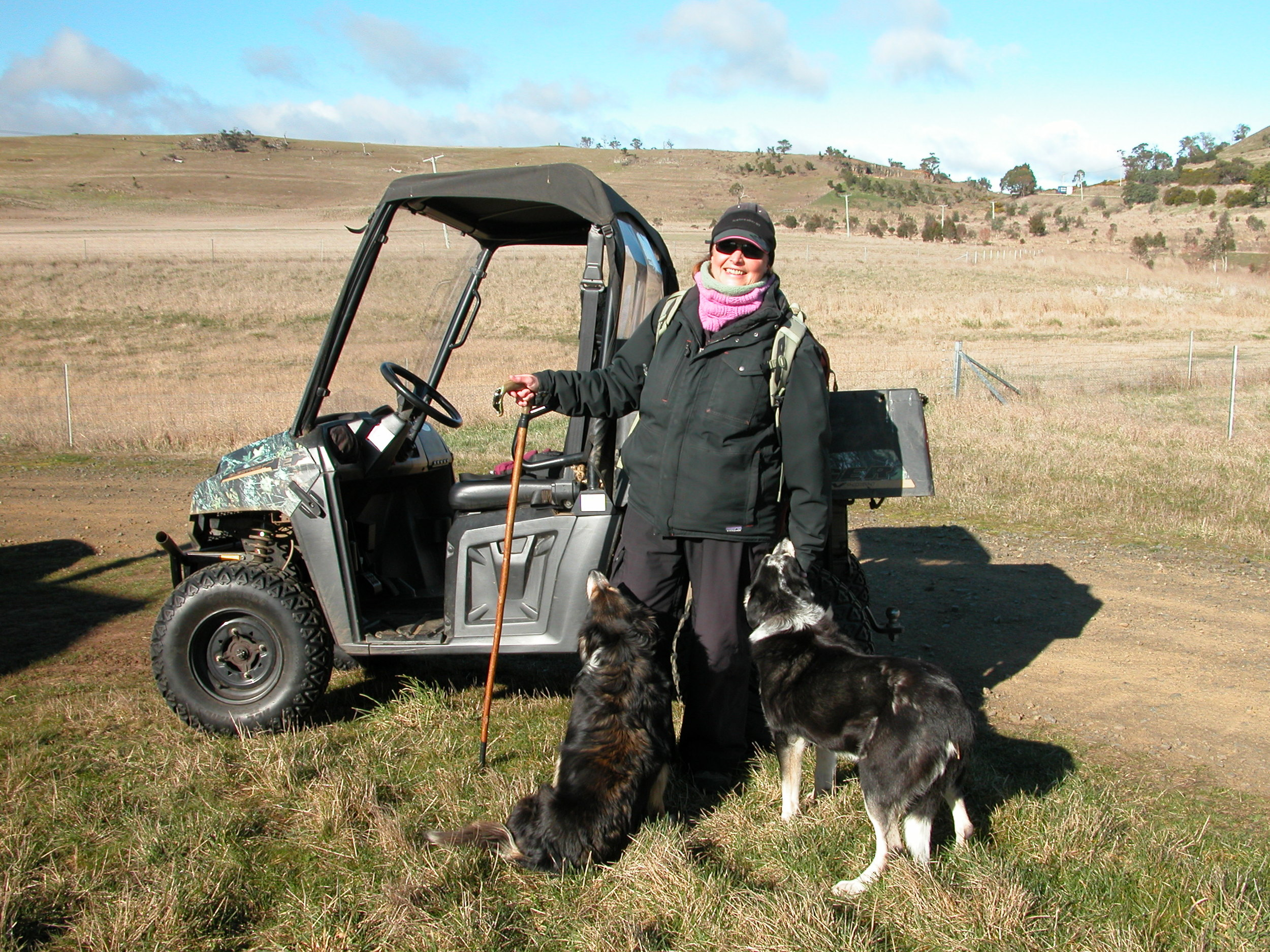 Janie, Chance and me, getting ready to go shepherding last winter. The only difference now is that I don't use the Polaris, and I've given up carrying the crook. A year of hiking up and down my hills has improved my balance, and the crook isn't big enough for me to catch a full-sized ewe anyway. If I have to catch one, now I just run them into one of my two sets of yards.
