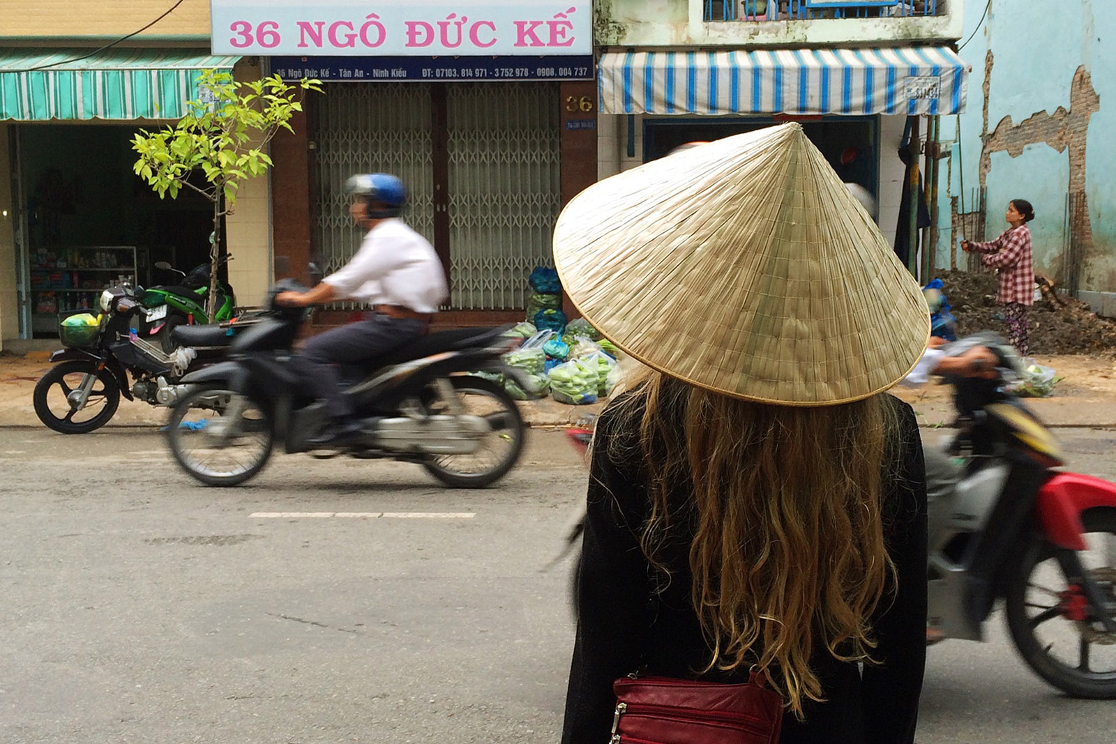 Our daughter Arkie taking in a street scene in Can Tho, Vietnam