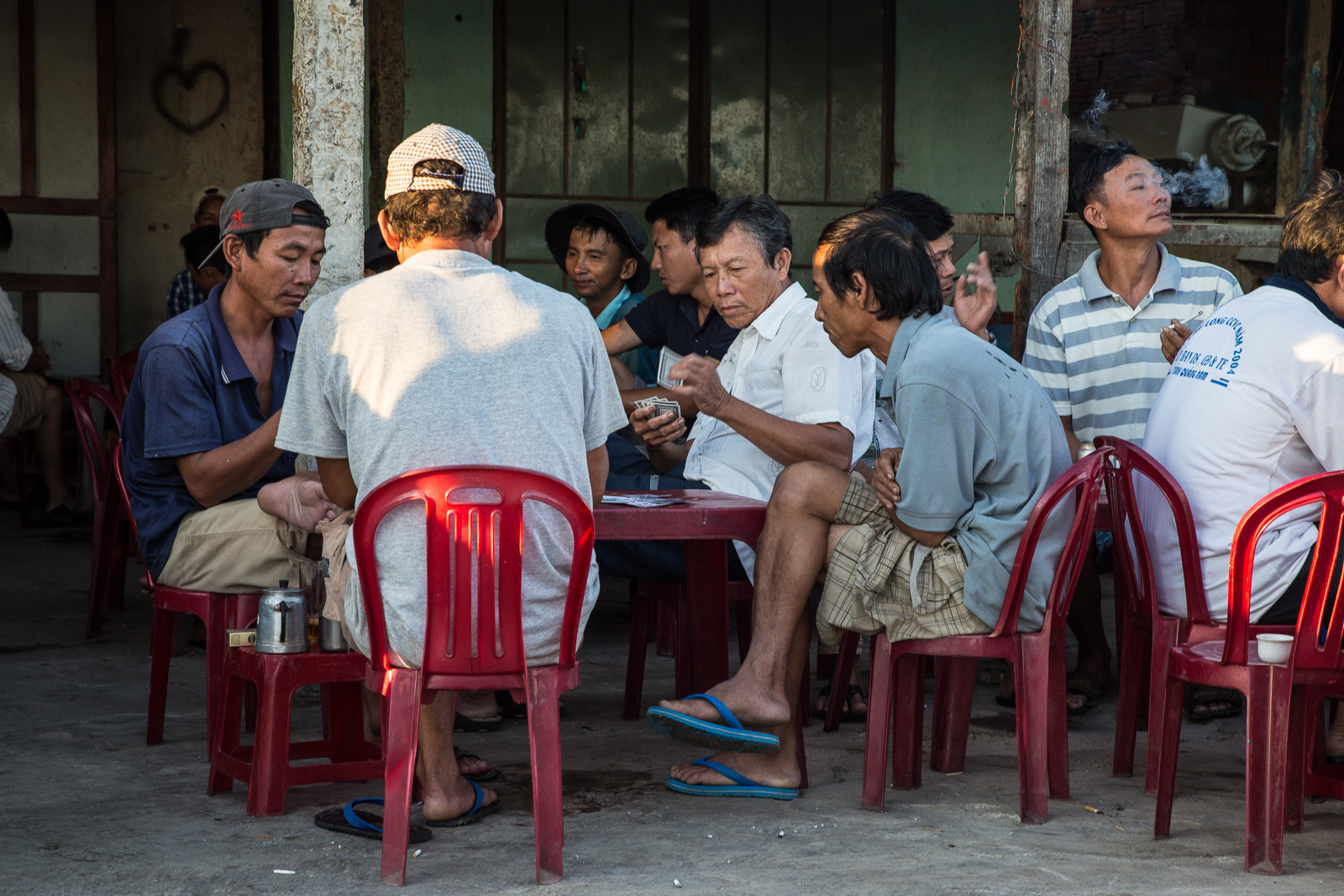 Some hard-earned down-time at 6.45am.The fishermen playing a few rounds of knock-off cards and drinking coffee at Duy Vinh Village.