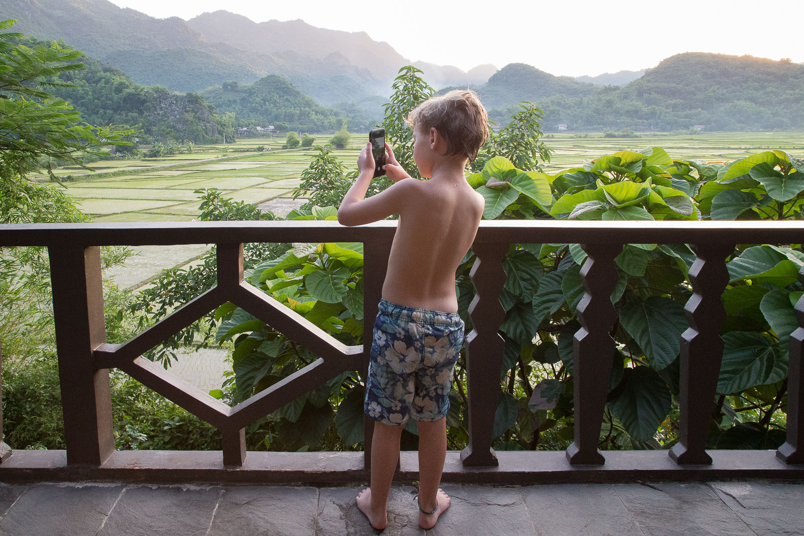 Ziggy can't resist a snap of the breathtaking view from our balcony at the Mai Chau Eco Lodge.