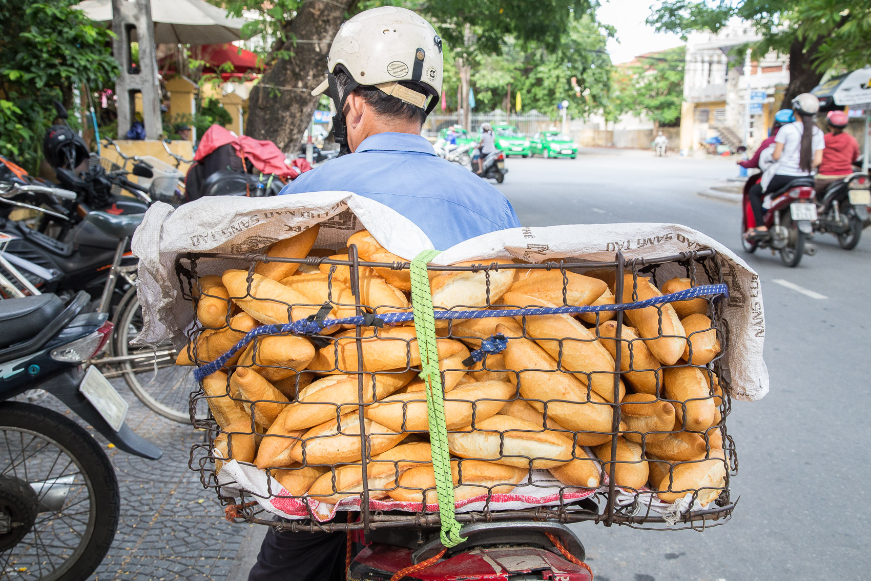 In Vietnam's tropical climate banh mi freshness is paramount. Humidity is a real factor here and bread tends to go stale and rubbery very quickly.