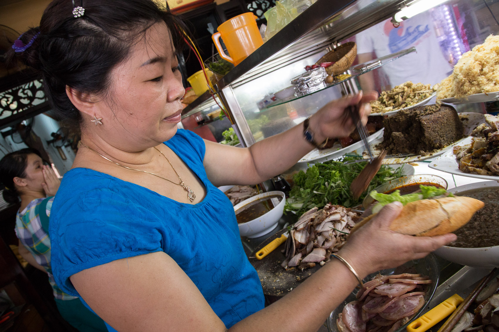 Madam Phuong pictured behind her counter.