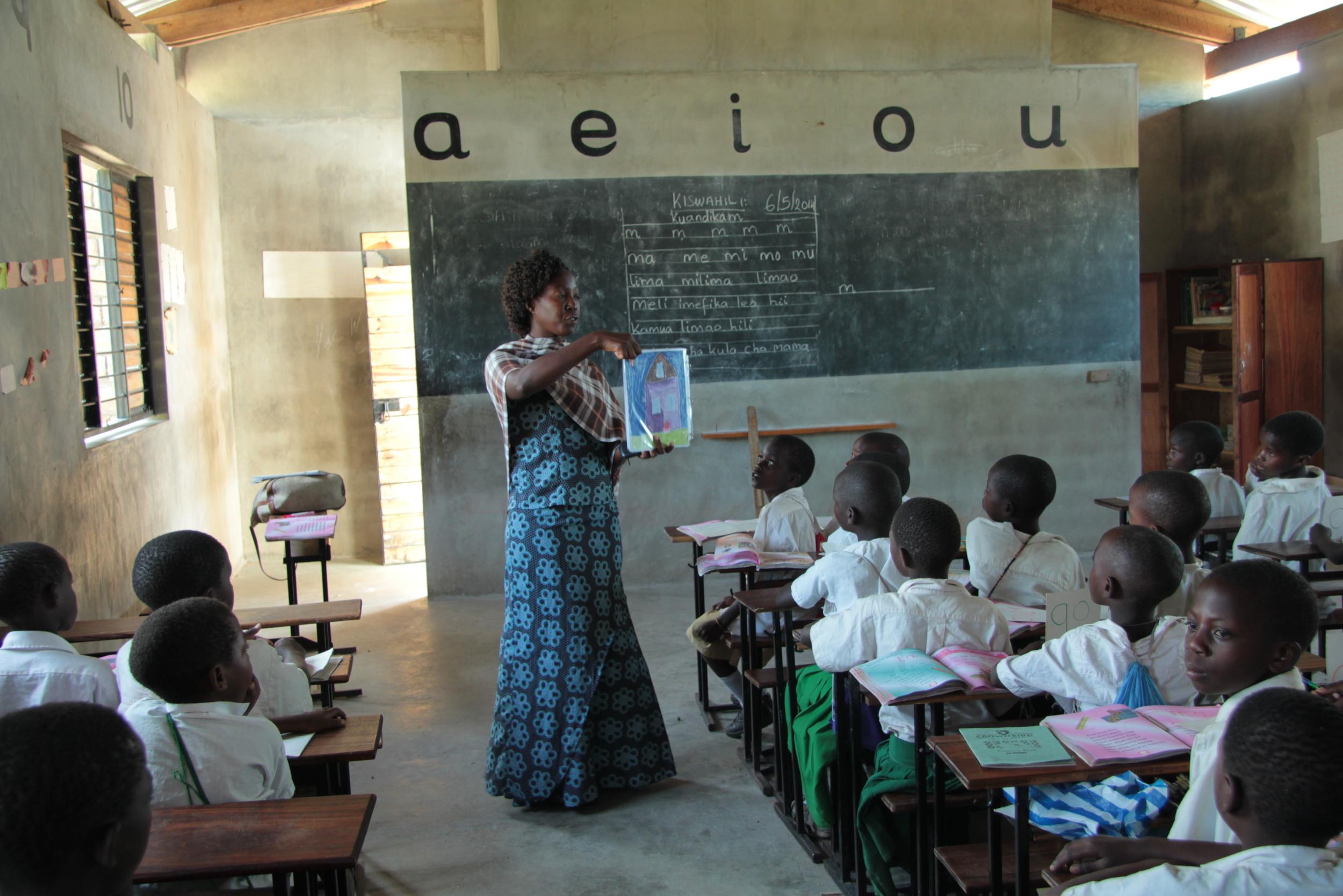 ntulya teacher in classroom.JPG