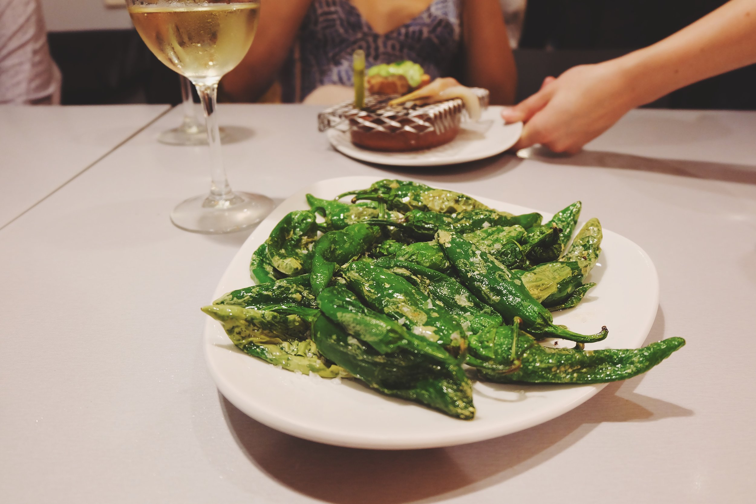 Grilled salted green peppers