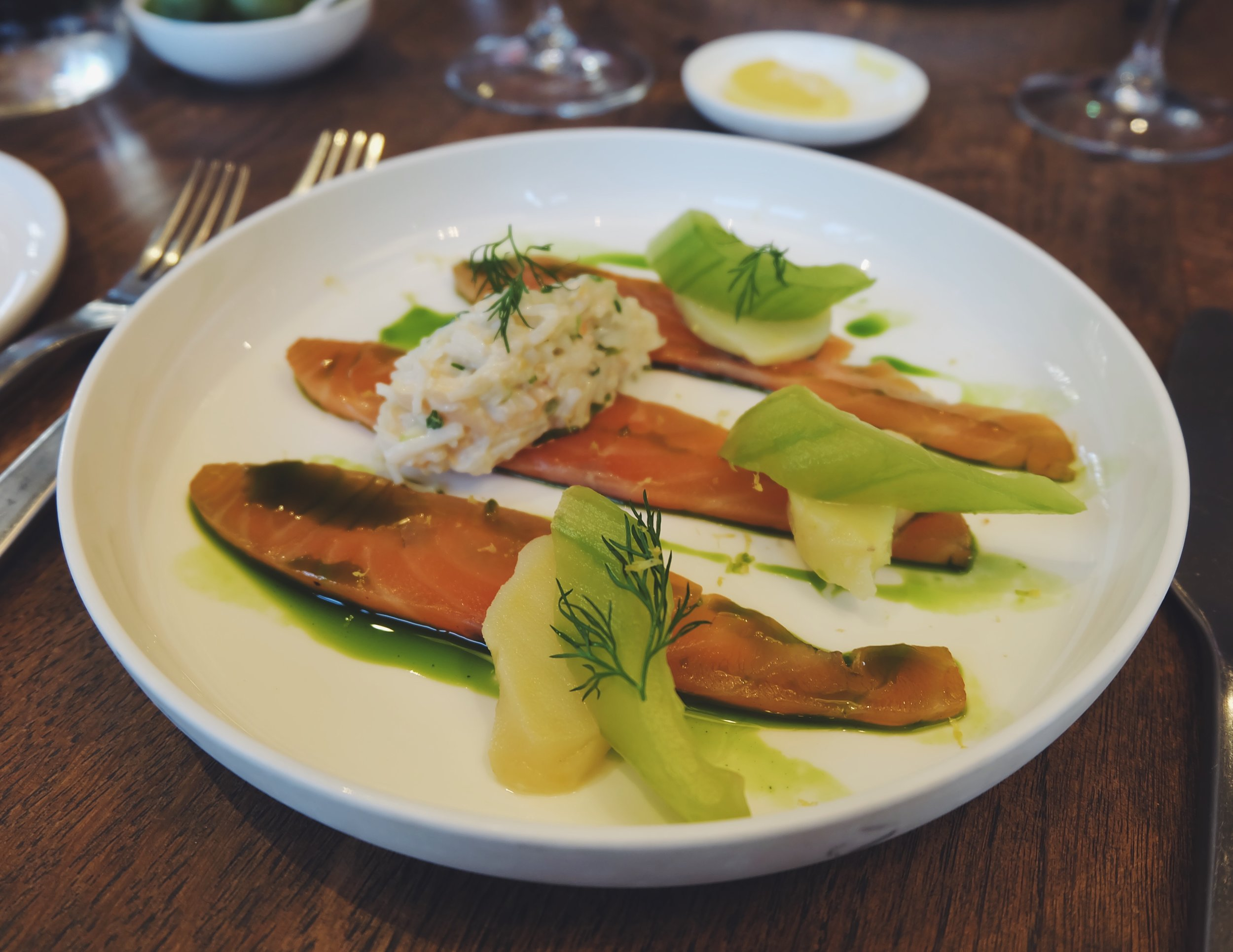 Clementine cured salmon with pickled cucumber, dressed crab and dill