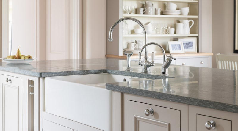 Neptune Chichester Range – Central island unit with dark granite worktop and Belfast sink with beautiful tap fittings