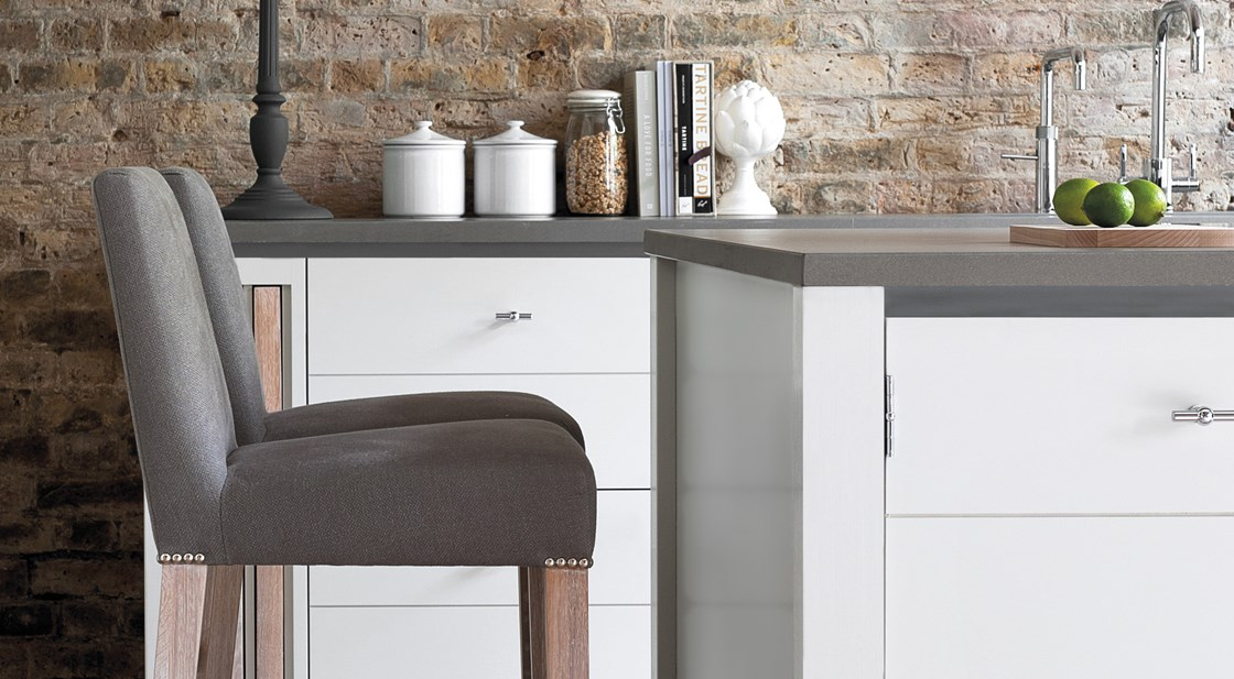 Neptune Limehouse Range – Comfy kitchen stools at breakfast bar in modern industrial handmade kitchen