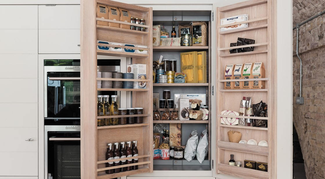 Neptune Limehouse Range – Modern industrial larder unit with open door storage pantry with food and spices