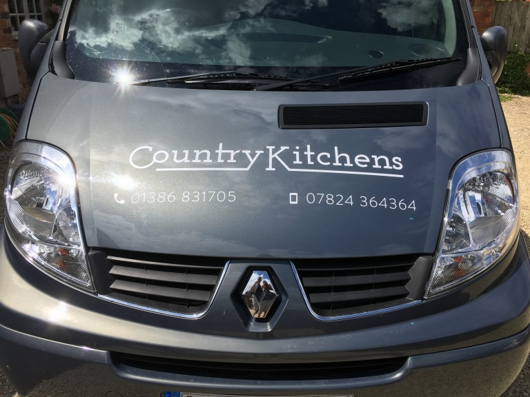 Country Kitchens van - Front view with logo and phone number