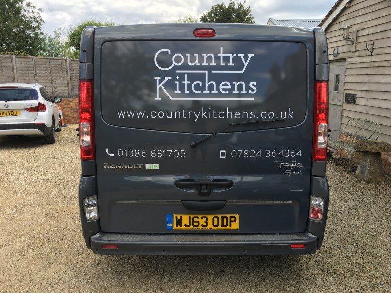 Country Kitchens van - Back view with logo and phone number