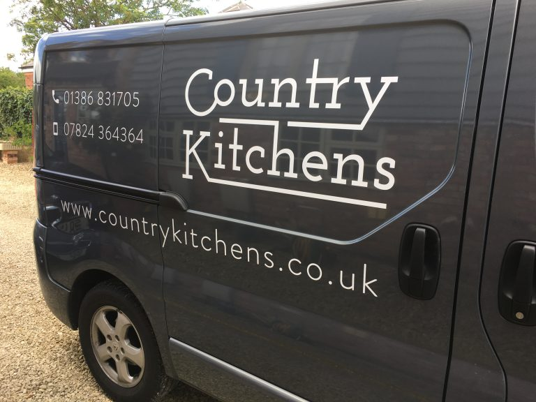 Country Kitchens van - Side view with logo and phone number