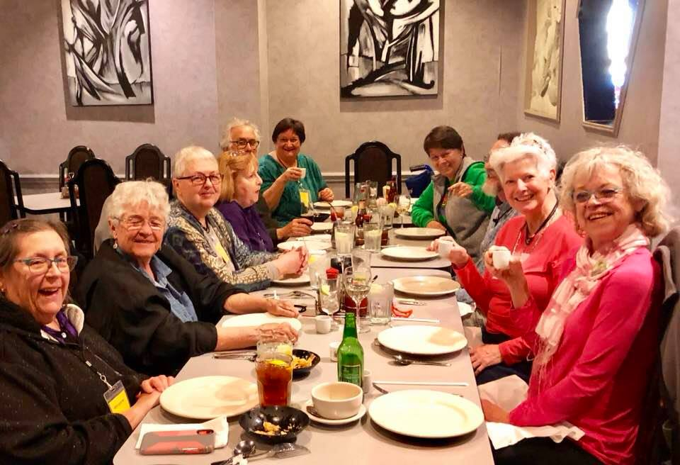 Village Hearth Senior Cohousing residents in Durham, North Carolina enjoy a community dinner together.