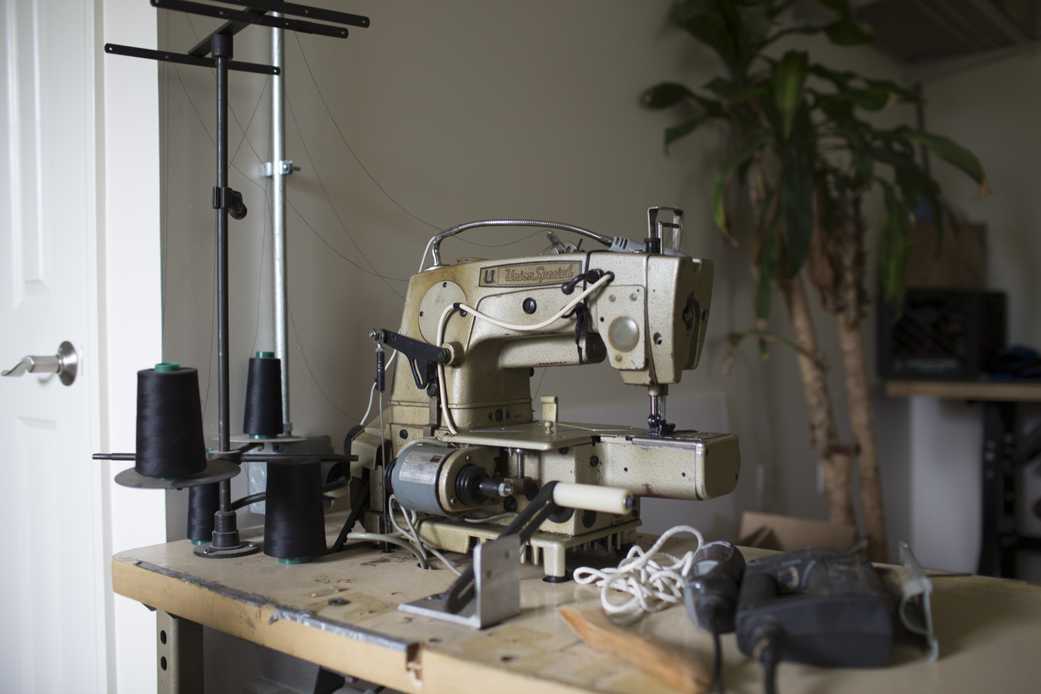 One of many vintage sewing machines in Renna's workshop