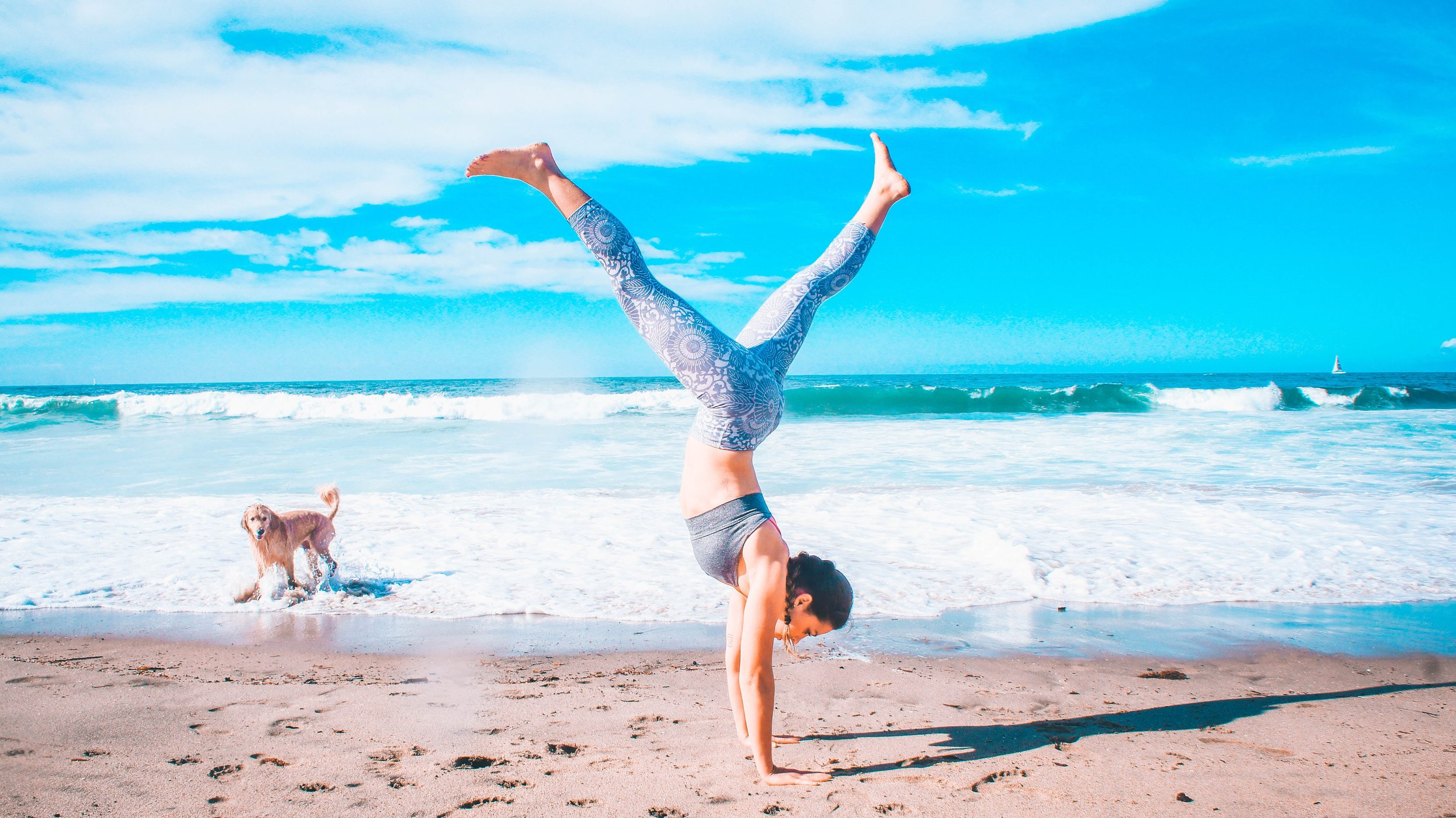 beach yoga handstand dog