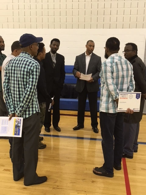 Metro Transit's Gary Courtney briefs several of the 57 candidates who signed up for Metro Transit operator training at the Cedar Riverside Opportunity Center.