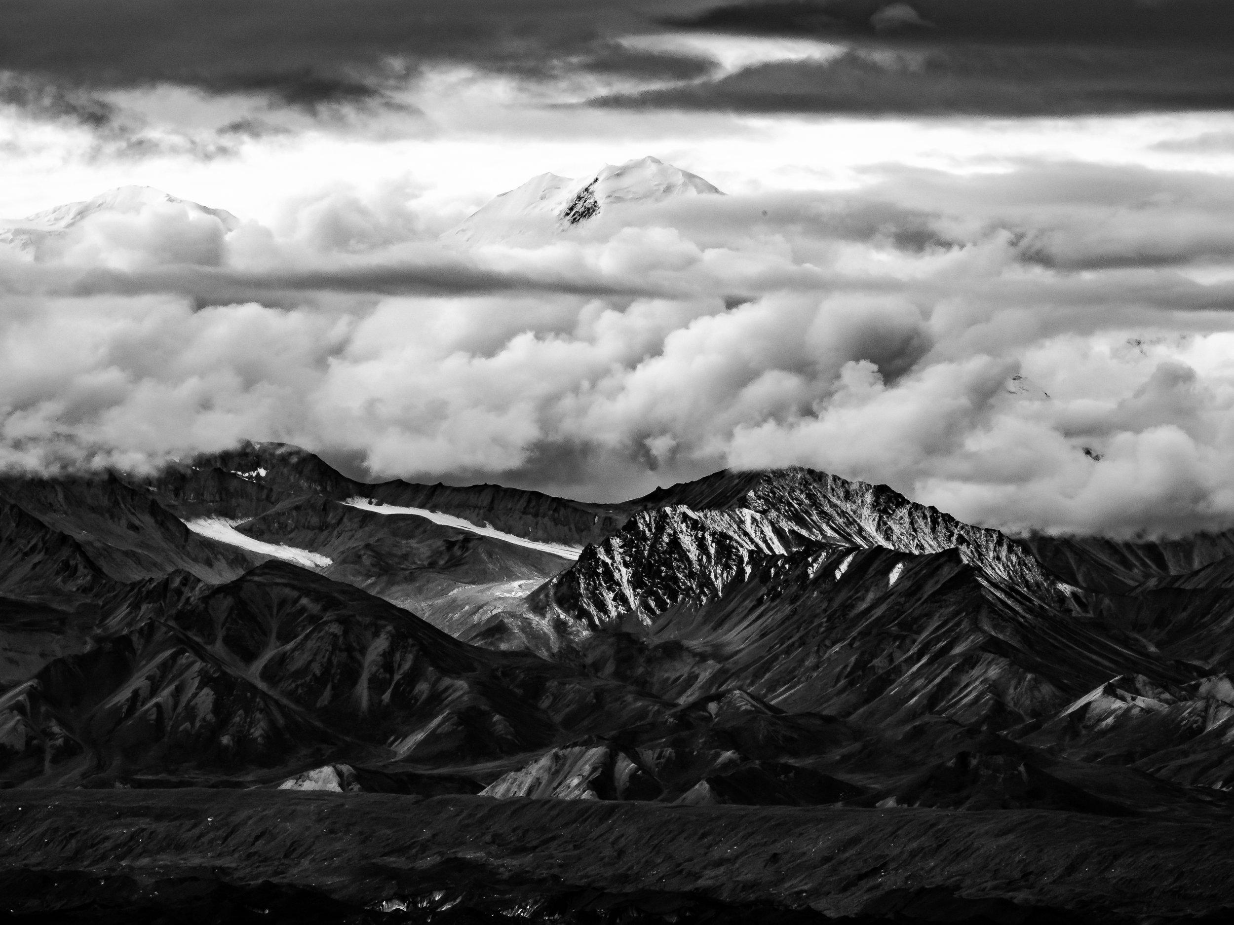 Denali's summit peeking above the clouds.