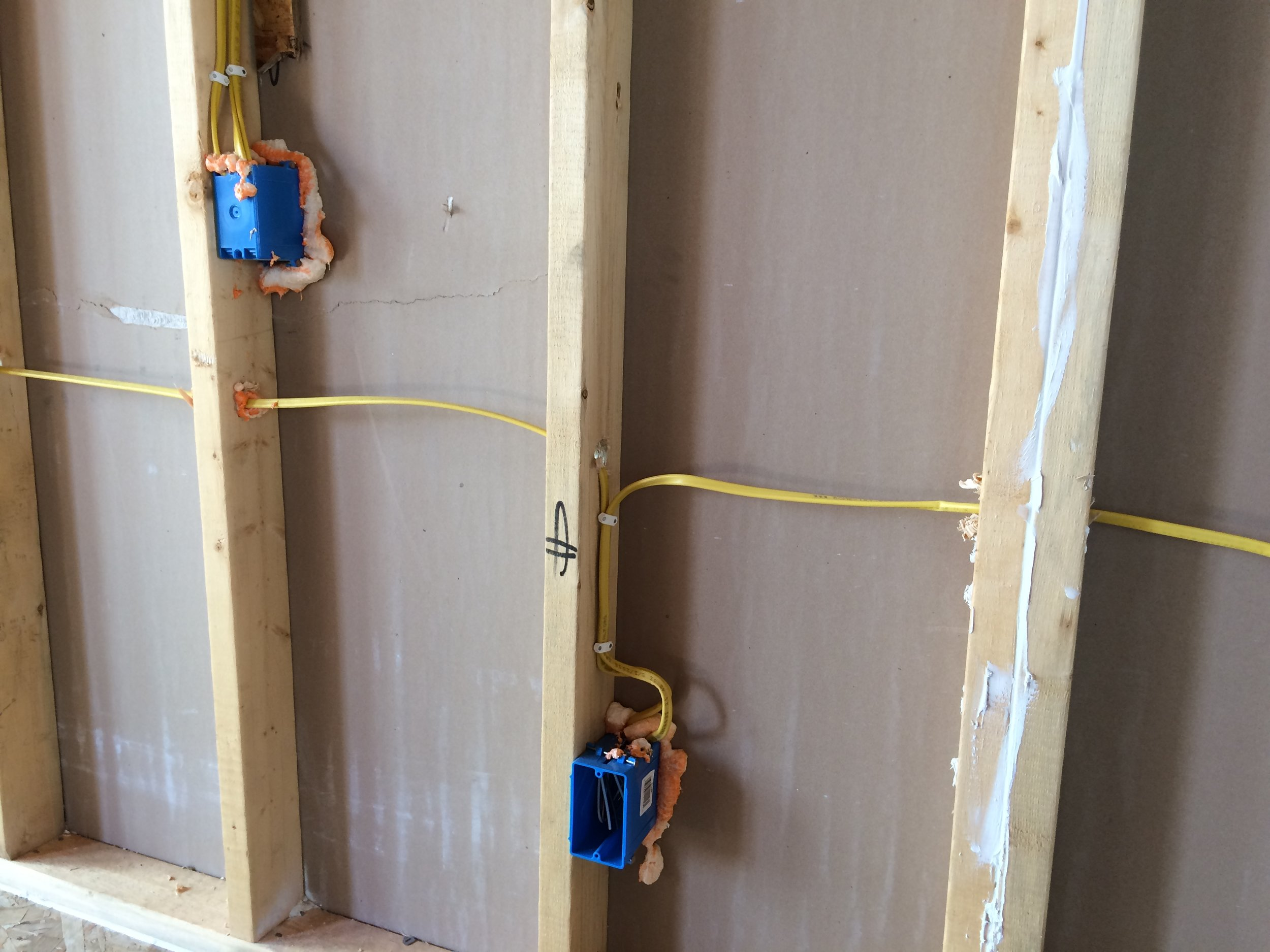Caulking/Foaming - Caulking and foaming is a critical step closing small air infiltrations between any gaps between framing. Double studs, corners and bottom plate framing is an overlooked airway that needs to be addressed to assure a tight building envelope
