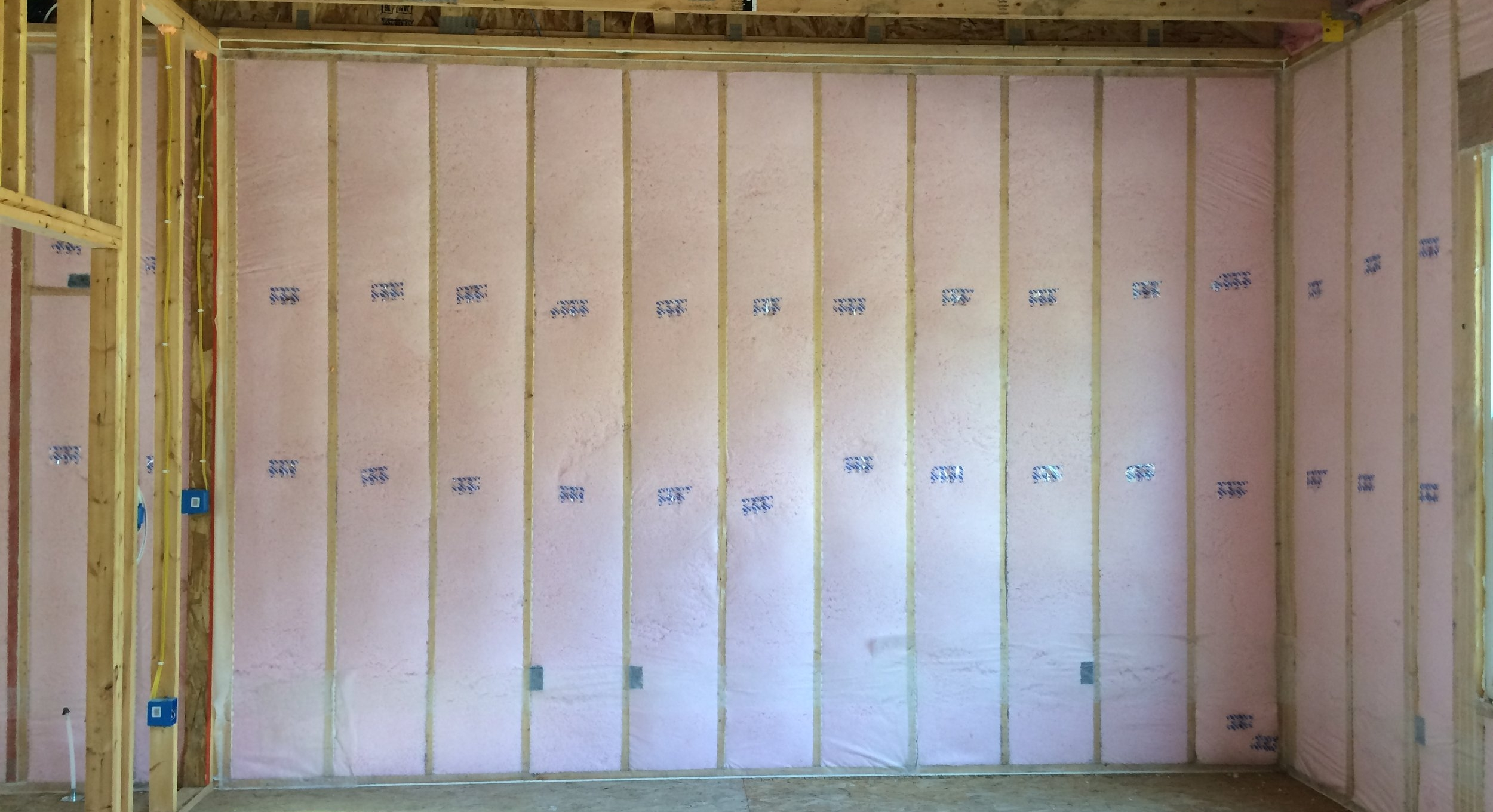 Blown-in insulation - Wall cavities are blown-in allowing no air pockets. This process provides a tight wall cavity with no voids.