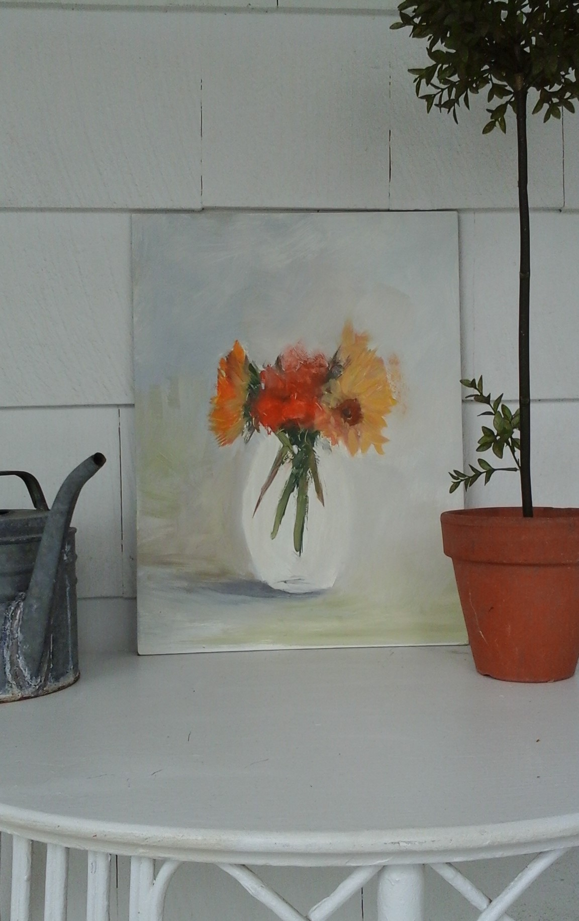 A sunflower painting I started a while back...still needs work on the vase and background but I'm liking the looseness and spontaneity of the flowers...
