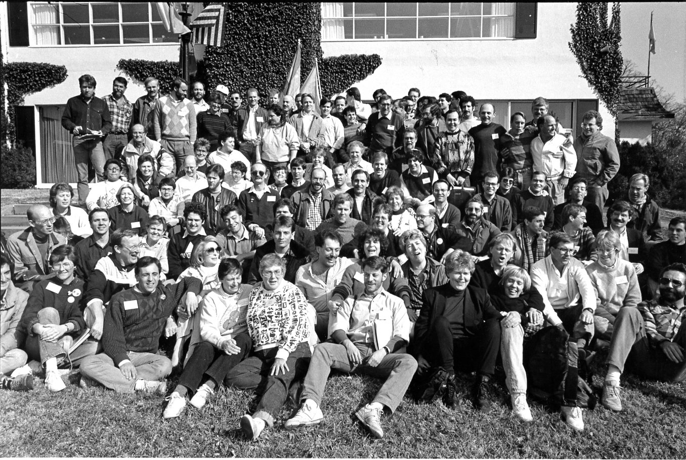 Dallas representatives clearly visible in this group photo:  BJ Anderson  (lower left corner, her hands around her right knee, wearing a dark sweater with white name tag),  Mike Grossman  (rear row, just right of center, wearing dark sweater with white shirt collar and white name tag), and  John Thomas  (third in from the upper right corner, standing behind the man in the white jacket).
