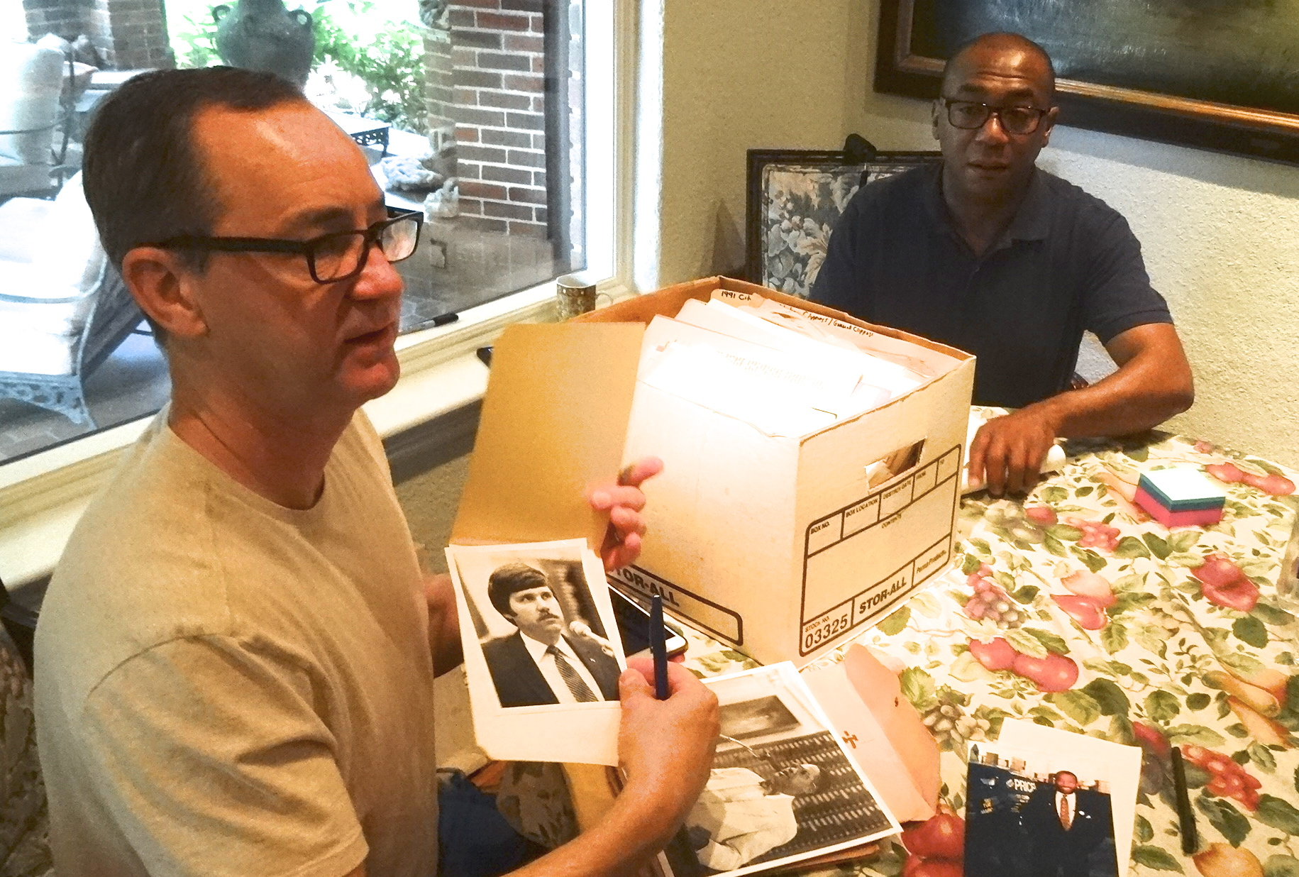 Board Members Steve Atkinson and Terry Loftis curate documents donated to The Dallas Way by the GLBT community.