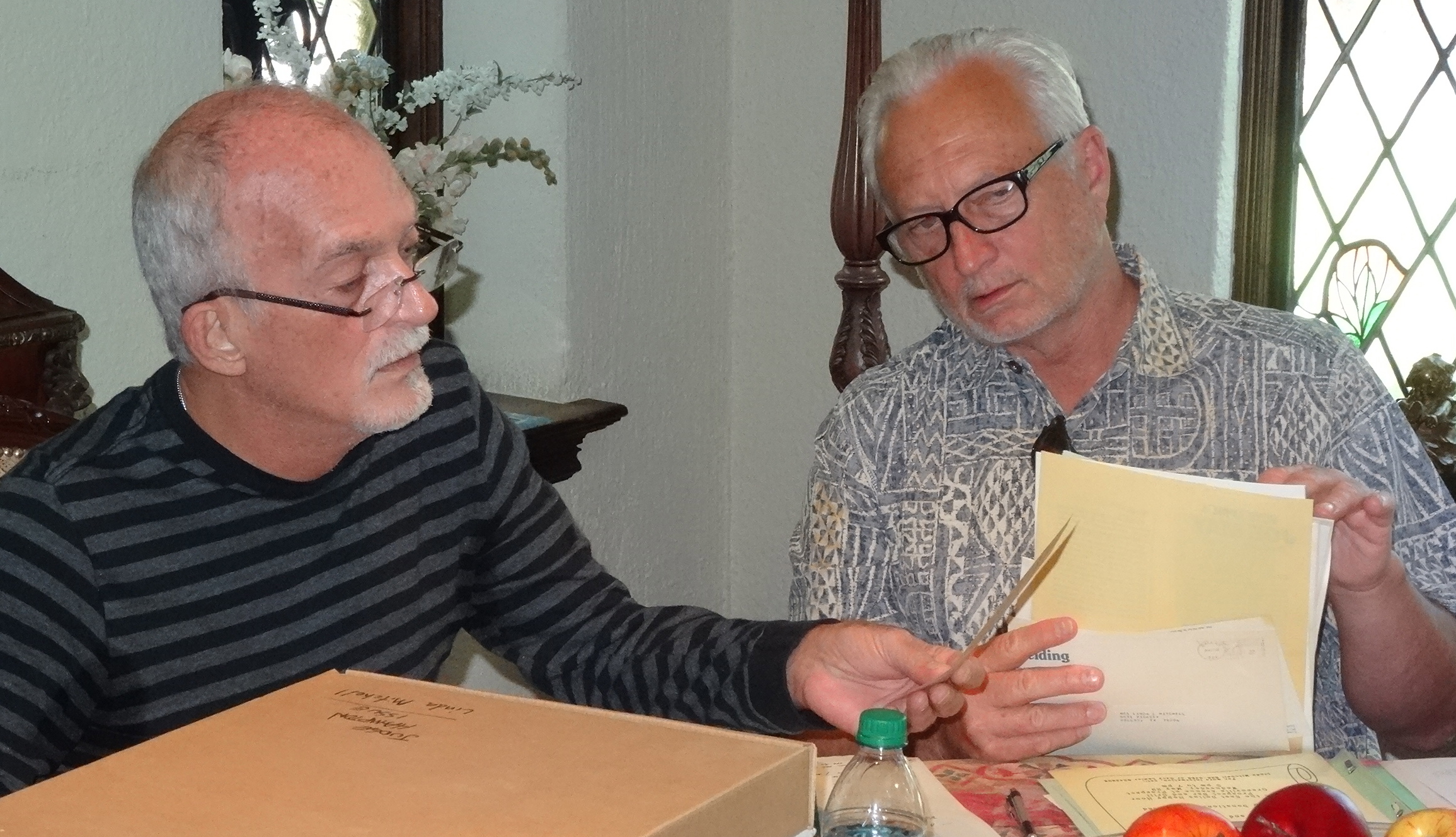 Board Members Terry Bucher and Buddy Mullino curate documents donated to The Dallas Way by the GLBT community.