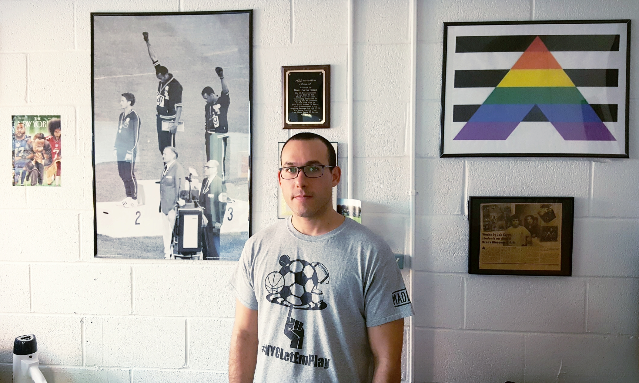 """Among Mr. Garcia-Rosen's inspirations: Tommie Smith and John Carlos, black sprinters who staged a """"black fist"""" protest at the 1968 Olympics in Mexico;former San Francisco 49ers quarterback and racial justice activist Colin Kaepernick;and Martin Luther King, Jr. With the support of his students, he founded the  NYC Let 'Em Play  movement to raise awareness of sports inequity in New York City high schools.  Pictured here in his dean's office at Bronx Academy of Letters"""