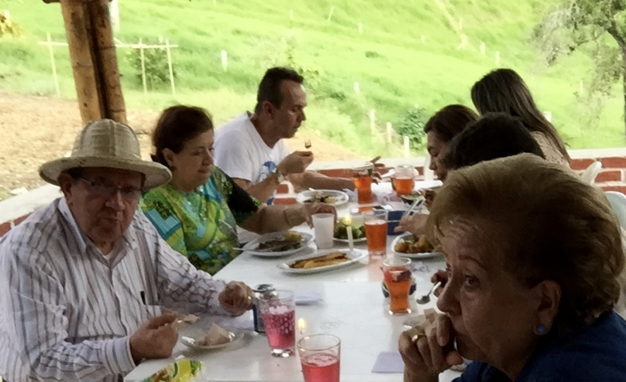 Family members finish delicious lunch feast under the roof of the outside patio dining area.