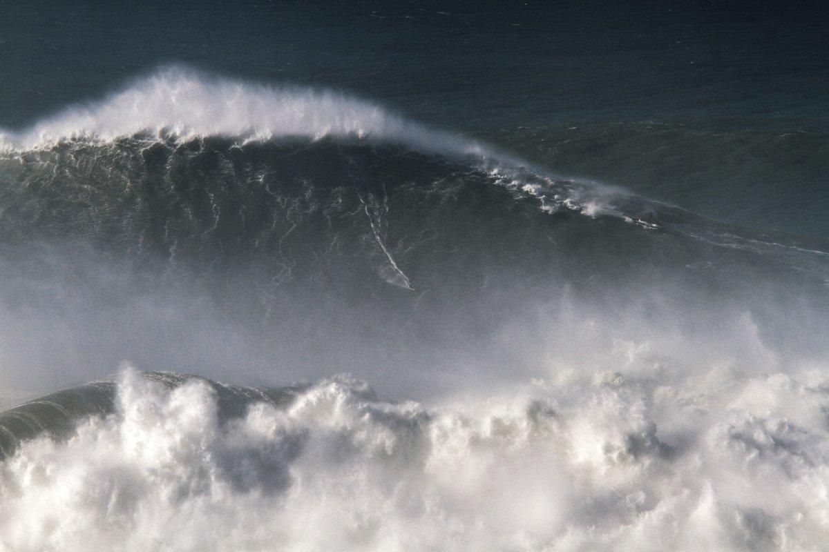 Brazilian surfer Rodrigo Kona rides his record-setting 80-foot monster wave at Nazare, Portugal.  Photo taken November 8, 2017.  (Photo: Pedro Cruz/AP)