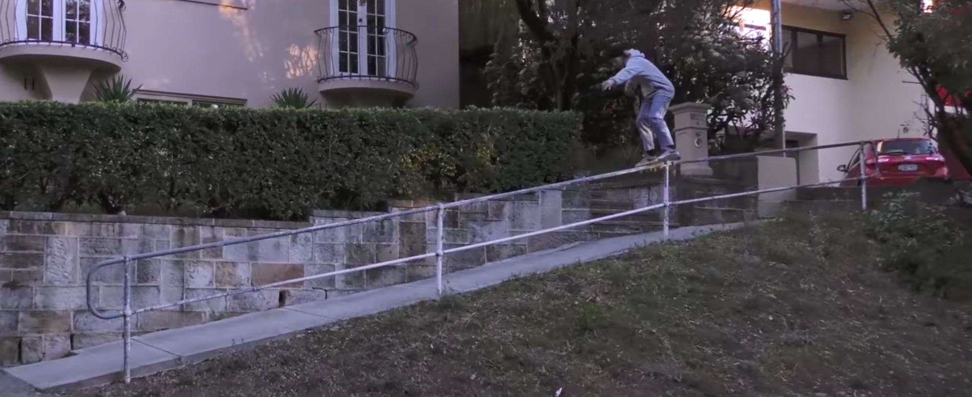 Rowan Davis with a heavy boardslide down a handicap rail.