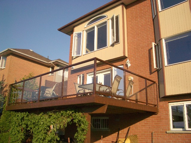 Metal rails with glass panels by ProBuilt
