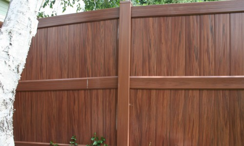 Solid privacy vinyl fence by Gorilla Deck.