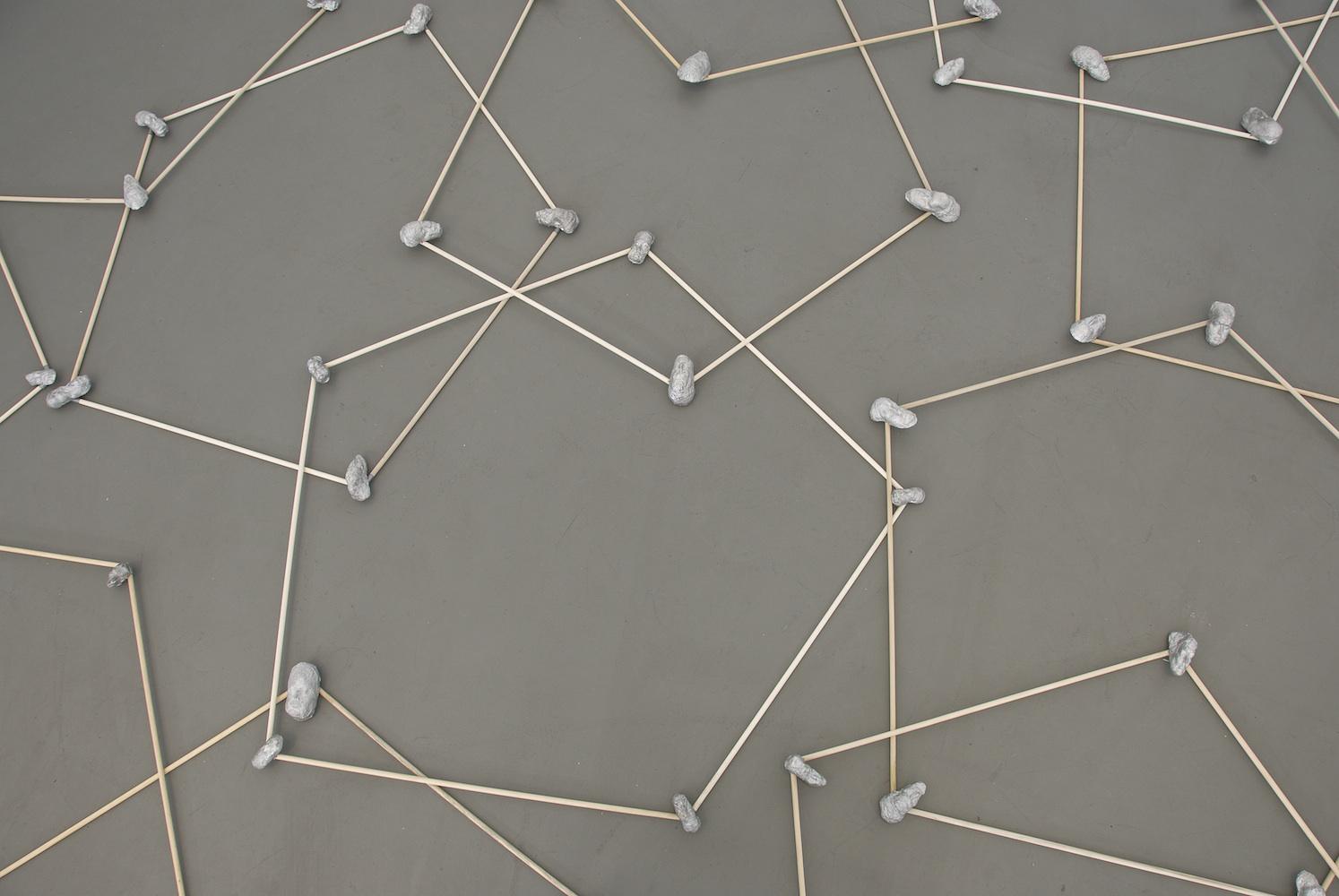 Floor Pentagons , 2010 Wood, cast aluminum, 36-inch diameter