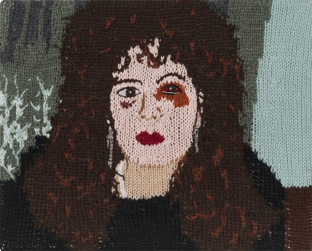 Feminist Fan #20 (Nan Goldin, Nan, one month after being battered, 1984) , 2016. Hand knitted wool and acrylic yarns, canvas and timber, 12 x 15 inches