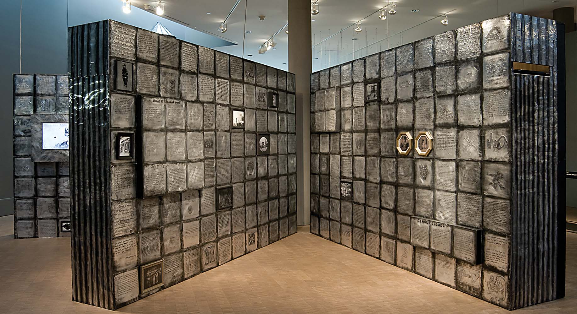 (un)Seen Work   (walk-in book), community-based installation, 2010-11 embossed metal on wood, text, video, audio, 8ft. x 12f.t x 20 ft.(each panel)