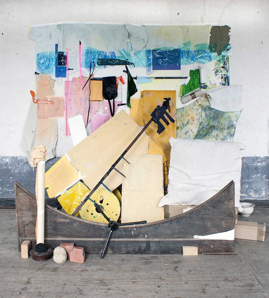 The bed and the church, 2015, Found objects, bed frame, wood, paper, tape, plastic water bottles, fabric, bricks, ceramic bowl, pillow and wooden chairs, 62 x 58 x 40 inches
