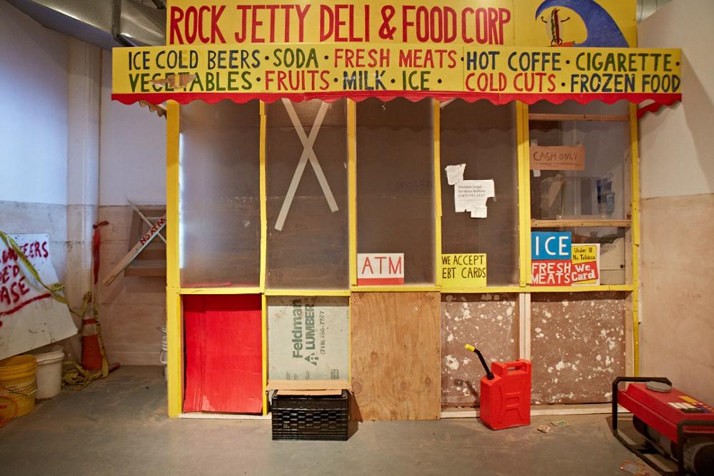 Rock Jetty Deli & Food Corp, 2013, Wood, Plexiglas, found and salvaged materials, cardboard, video projection, audio loop, 14 x 15..5 x 10 feet