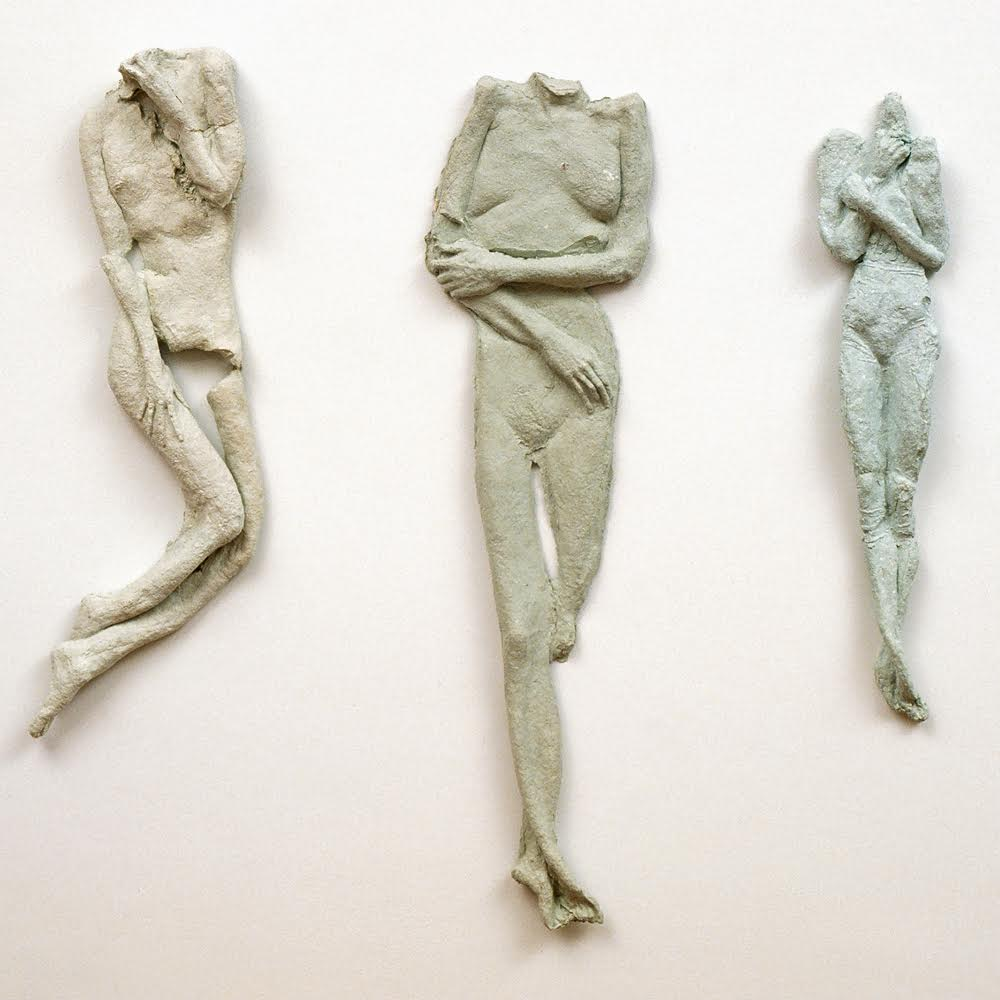 Three Figures , 1996, Handmade cast paper, 38 x 9, 47 x 12, 35 x 7 inches  (L to R)