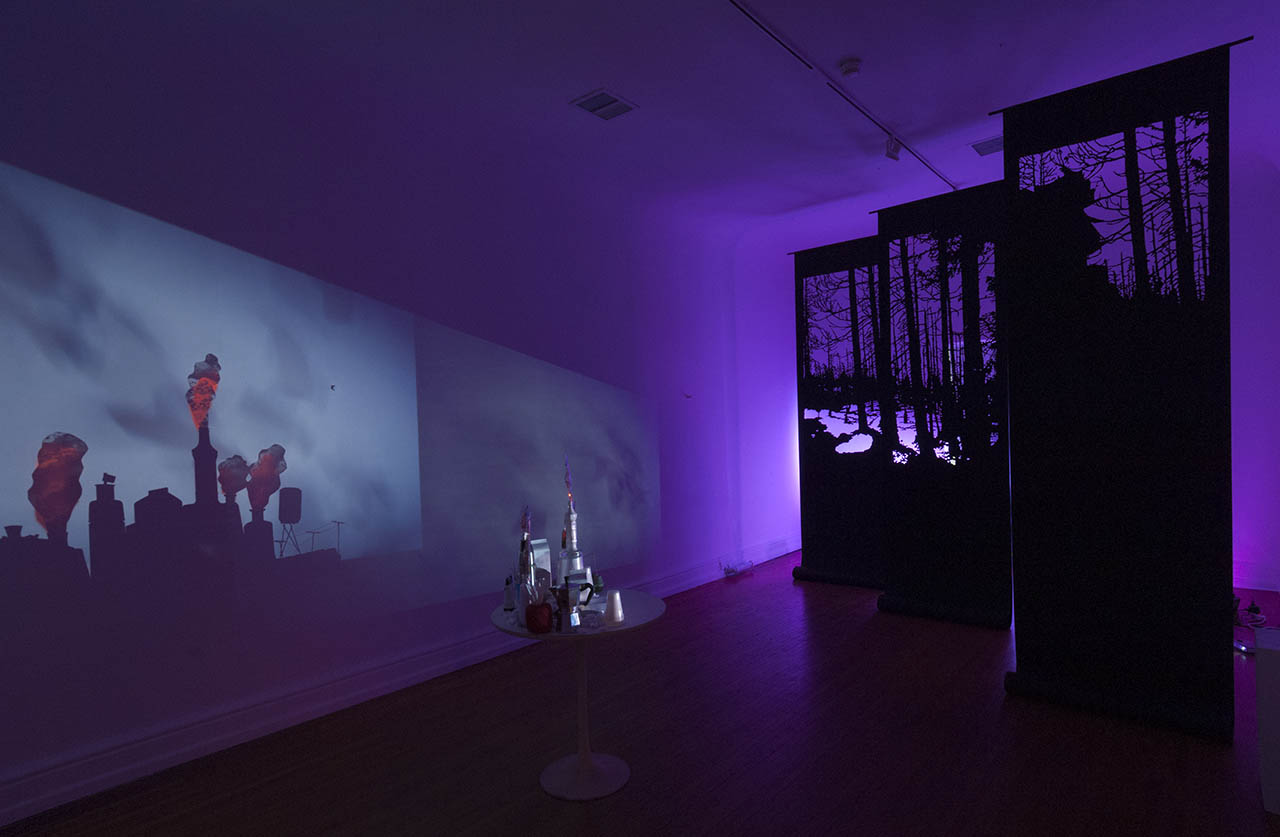 Geist (left) Transience (right). 2016, paper, found objects, light, video, room dimension 11' x 20' x 12'