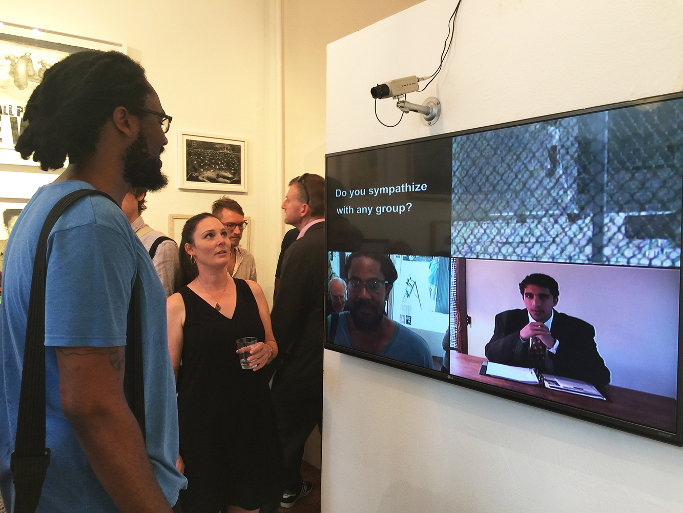"""""""home.land.security"""" Electronic site installation, completed 2016. 4-Channel video, switcher, Tivo.Quad- split screen for flatscreen or projection: [Clockwise from upper Left]: Video Text –actual questions from Homeland Security interrogation; Tour of Guantanamo Bay Prison (downloaded Network broadcast); 'Border agent' (performance with audio); live delayed video of viewer (TIVO). https://vimeopro.com/fuzeart/homelandsecurity"""
