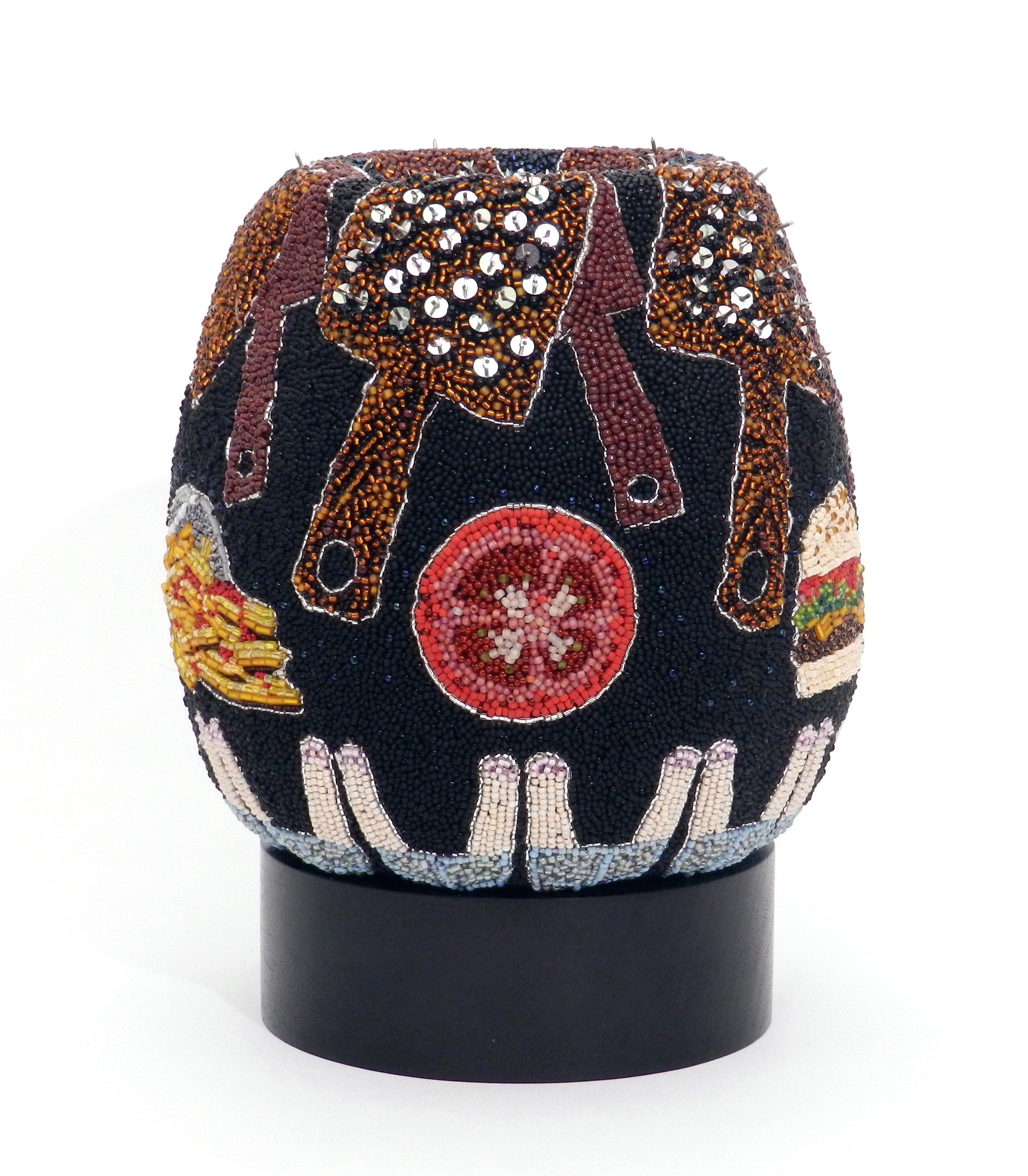 Stuffed , 2017, felt, glass beads, sequins, thumbtacks, 8.5 x 6.5 x 6.5 in.