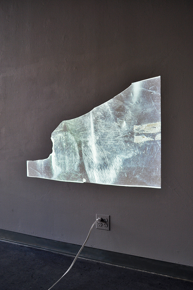 Surface scan, fragment stage,  2015, Scanned reflective mylar fragment projected on a middle grey wall, 38'' x 24''