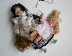 Ladies (don't hit boys) , 1970  A recorded text, hidden in a pile of dolls, repeats the rules for being a lady in an admonishing tone.