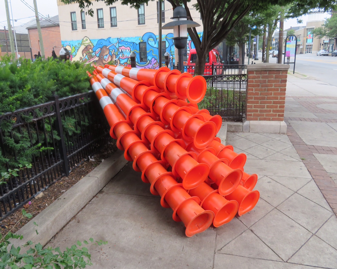 Cascade , 2018, traffic cones and steel cable, 44 x 87 x 90 inches