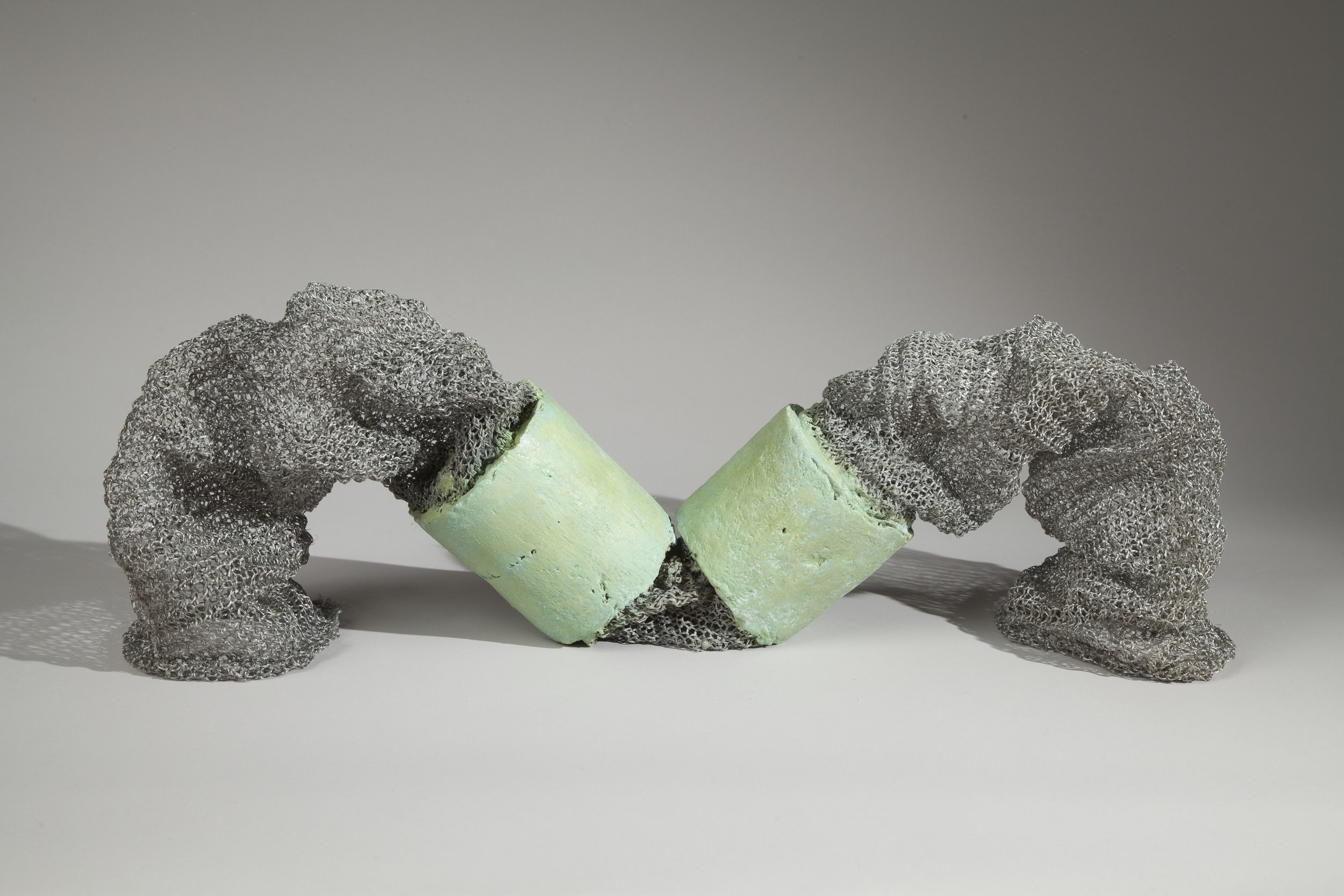 Ooze , 2016, cast concrete, pigments, and reclaimed metal, 9 x 22 x 6 inches