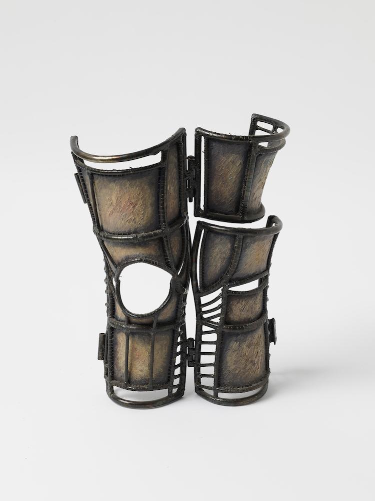"Knee Chamber , 1980s Steel, fabric, 15"" x 6.5"" x 8"""